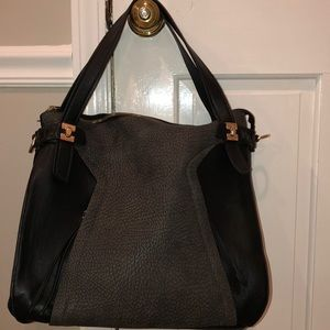 Black and grey purse with gold hardware
